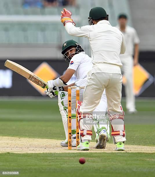 Pakistan batsman Azhar Ali sweeps a ball fine past Australia's wicketkeeper Matthew Wade on the third day of the second cricket Test match in...