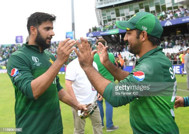 Pakistan batsman Imad Wasim is congratulated by captain Sarfraz Ahmed after the Group Stage match of the ICC Cricket World Cup 2019 between Pakistan...