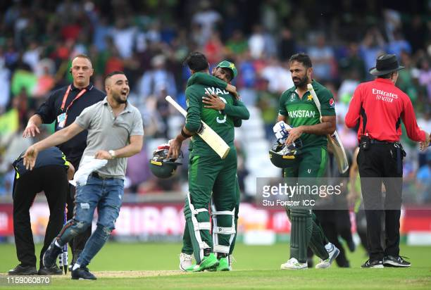 Pakistan batsman Imad Wasim is congratulated by Hasan Ali after hitting the winning runs after the Group Stage match of the ICC Cricket World Cup...