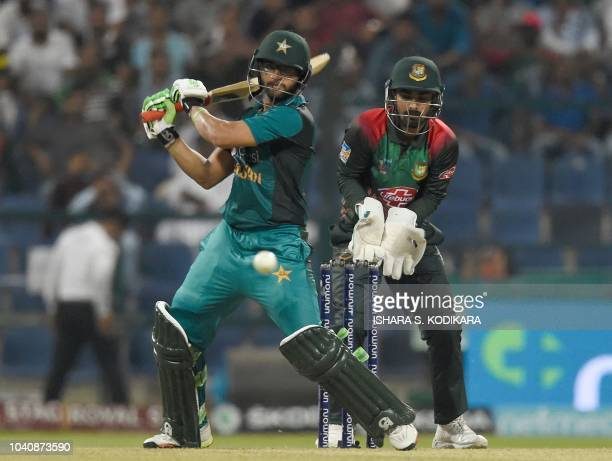Pakistan batsman ImamulHaq plays a shot as Bangladesh wicketkeeper Liton Das looks on during the one day international Asia Cup cricket match between...