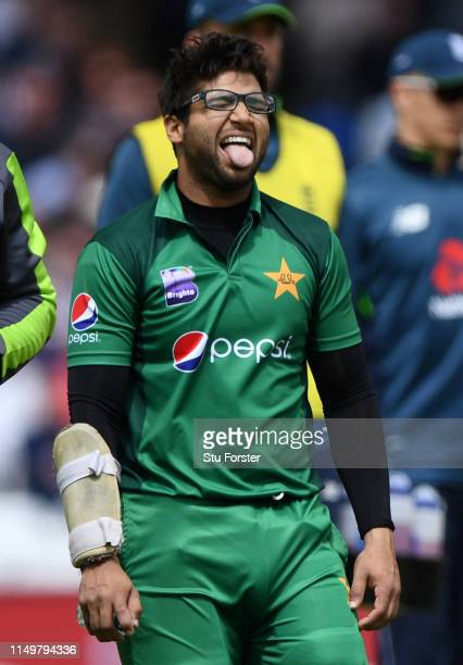 Pakistan batsman ImamulHaq reacts as he leaves the field injured after taking a blow on the elbow during the 4TH One Day International between...