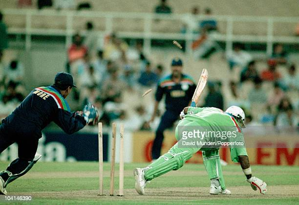 Pakistan batsman Javed Miandad survived this stumping attempt by Indian wicketkeeper Kiran More during the World Cup match between Pakistan and India...