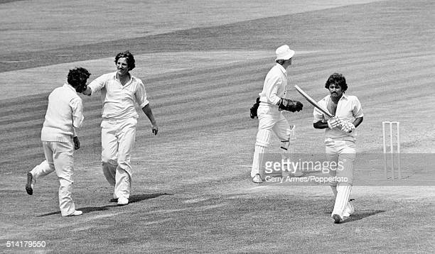 Pakistan batsman Javed Miandad walks off after being caught by England captain Mike Brearley off the bowling of Phil Edmonds for 39 in Pakistan's 2nd...