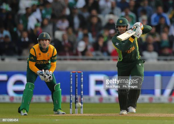 Pakistan batsman Misbah ul Haq drives a shot watched South Africa wicketkeeper AB de Villers during the ICC Champions Trophy match at Edgbaston...