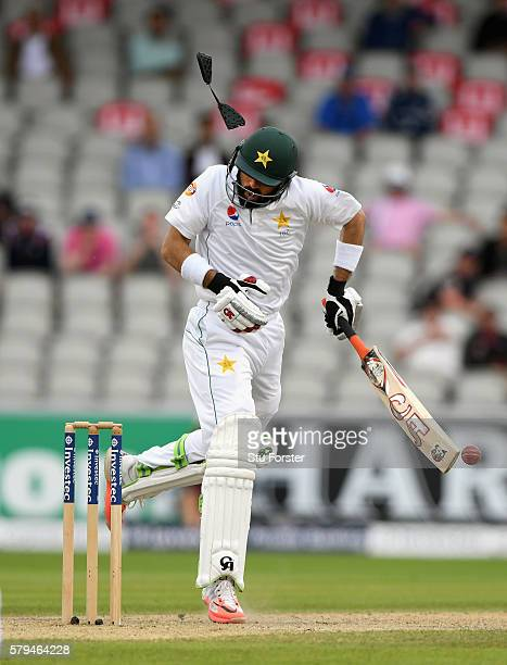 Pakistan batsman MisbahulHaq is hit on the helmet by a short ball from Chris Woakes dislodging part of it during day three of the 2nd Investec Test...