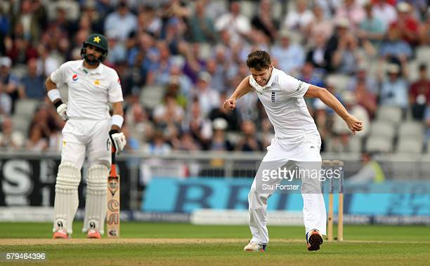 Pakistan batsman MisbahulHaq looks on as Chris Woakes celebrates dismissing Pakistan batsman Yasir Shah during day three of the 2nd Investec Test...