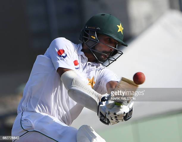 Pakistan batsman Mohammad Amir hits a four from a ball by West Indies bowler Devendra Bishoo on the fourth days play of the final test match at the...