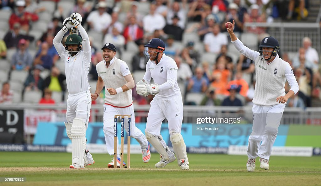 Pakistan batsman Mohammad Hafeez is caught by Gary Ballance (r) off the bowling of Moeen Ali during day four of the 2nd Investec Test match between England and Pakistan at Old Trafford on July 25, 2016 in Manchester, England.