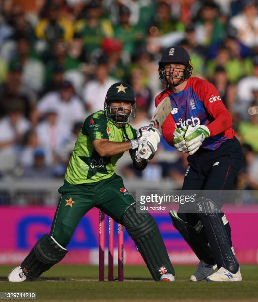 Pakistan batsman Mohammad Rizwan in batting action watched by Jos Buttler during the 3rd Vitality T20 match between England and Pakistan at Emirates...