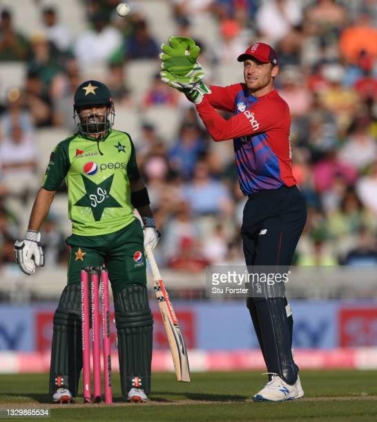 Pakistan batsman Mohammad Rizwan looks on as Jos Buttler takes a ball during the 3rd Vitality T20 match between England and Pakistan at Emirates Old...