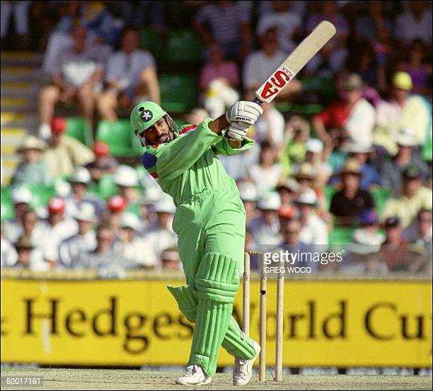 Pakistan batsman Ramiz Raja hits out against the bowling of Australia's Mike Whitney in World Cup cricket action in Melbourne 11 March 1992 Pakistan...