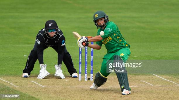 Pakistan batsman Sana Mir hits out watched by New Zealand wicketkeeper Rachel Priest during the ICC Women's World Cup 2017 match between New Zealand...