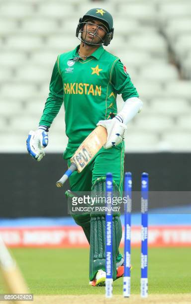Pakistan batsman Shadab Khan reacts after being runout by Bangladesh's Mehedi Hasan Miraz during the ICC Champions Trophy Warmup match between...