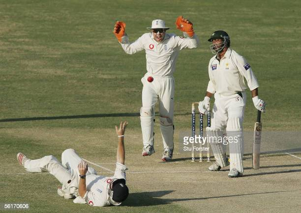 Pakistan batsman Shoaib Akhtar is caught by Ian Bell off the bowling of Ashley Giles as wicketkeeper Geraint Jones celebrates during the fourth day...