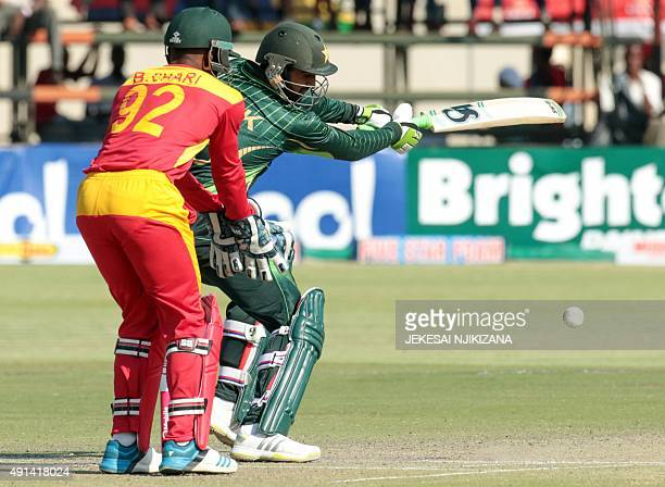 Pakistan batsman Shoaib Malik hits the ball during the final game in a series of three ODI cricket matches between Pakistan and hosts Zimbabwe at the...