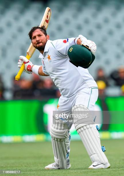 Pakistan batsman Yasir Shah celebrates scoring his century against Australia on the third day of the second cricket Test match in Adelaide on...