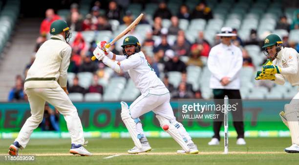 Pakistan batsman Yasir Shah hits a ball square from the Australian bowling on the third day of the second cricket Test match in Adelaide on December...