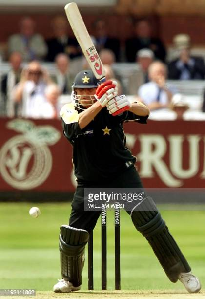 Pakistan batsman Younis Khan drives a ball from England fast bowler Andrew Caddick in their match being played at Lords in London 12 June 2001....