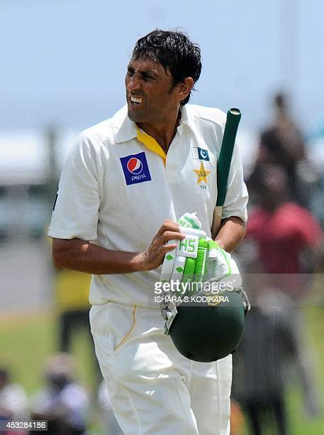 Pakistan batsman Younis Khan leaves the field after being dismissed by Sri Lankan cricketer Dilruwan Perera during the second day of the opening Test...