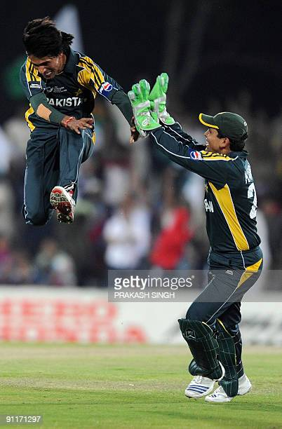 Pakistan bowler Mohammad Aamir celebrate with Pakistan wicket keeper Kamran Akmal the dismissal of Indian batsman Yusuf Pathan on September 26 2009...