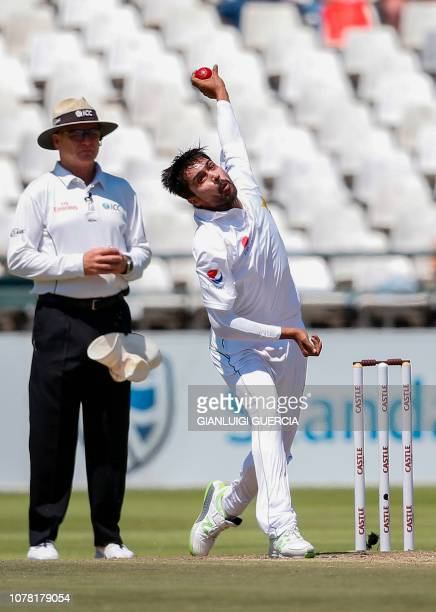 Pakistan bowler Mohammad Amir delivers a ball past umpire Bruce Oxenford during the fourth day of the second Test cricket match between South Africa...