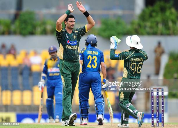 Pakistan bowler Mohammad Irfan celebrates with his teammates after he dismissed Sri Lankan batsman Tillakaratne Dilshan during the first One Day...