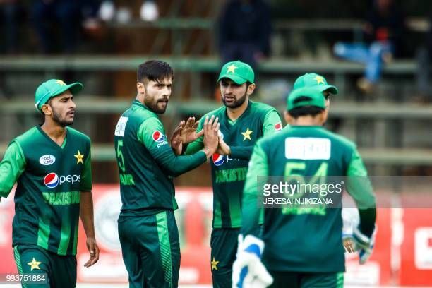 Pakistan bowler Muhammad Amir celebrates a wicket in action during the final of the triseries played between Pakistan and Australia in a T20...