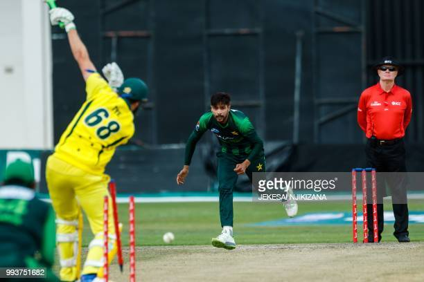 Pakistan bowler Muhammad Amir takes the wicket of Andrew Tye in action during the final of the triseries played between Pakistan and Australia in a...