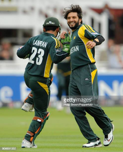 Pakistan bowler Shahid Afridi celebrates with wicketkeeper Kamran Akmal after the stumping of Netherlands batsman Daan van Bunge for 0 in the ICC...