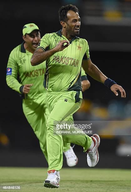 Pakistan bowler Wahab Riaz and Nasir Jamshed react after getting the wicket of Zimbabwe batsman Tawanda Mupariwa during the 2015 Cricket World Cup...