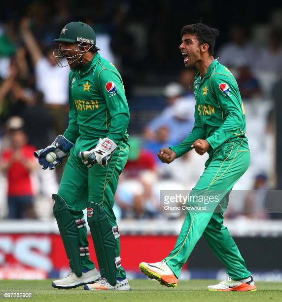 Pakistan captain and wicket keeper Sarfraz Ahmed celebrates after catching out India's Kedar Jadhav off of the bowling of Shadab Khan during the ICC...