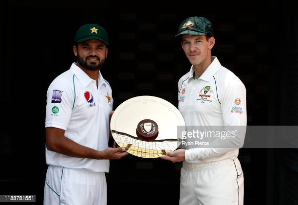 Pakistan Captain Azhar Ali and Australian Captain Tim Paine pose with the series trophy during the Captain's photo call at the Gabba on November 20...