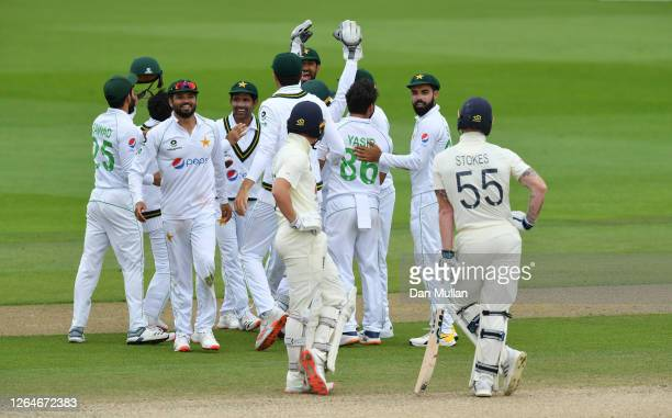 Pakistan captain Azhar Ali celebrates with teammates after the successful review to dismiss Ben Stokes of England during Day Four of the 1st...