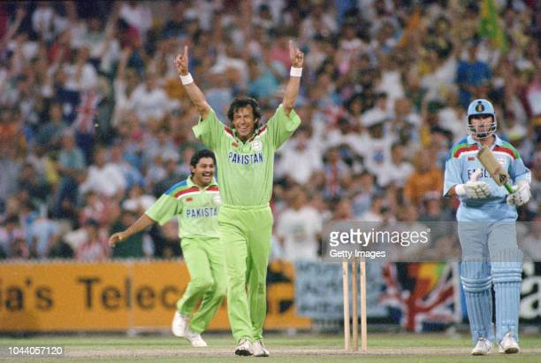 Pakistan captain Imran Khan celebrates the moment of victory after Rameez Raja had caught England batsman Richard Illingworth to win the 1992 Cricket...
