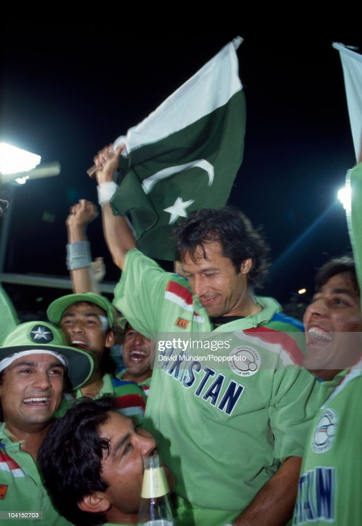 Pakistan captain Imran Khan (waving flag) celebrates with his team after the World Cup Final between Pakistan and England at the Melbourne Cricket Ground, 25th March 1992. Pakistan won by 22 runs.