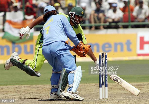 Pakistan captain InzamamulHaq makes it safely home to avoid a run out by Indian wicketkeeper Mahender Dhoni during the final one day international...