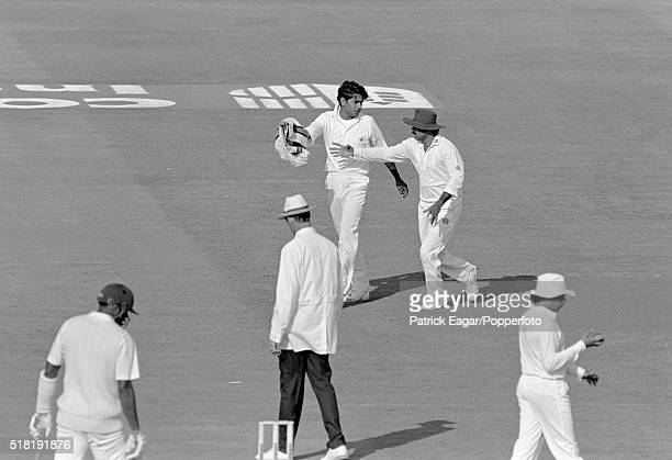 Pakistan captain Javed Miandad takes the sweater from Pakistan bowler Aqib Javed during the discussion with umpire Roy Palmer in the 3rd Test between...
