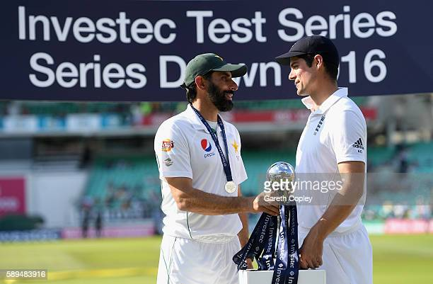 Pakistan captain MisbahulHaq and England captain Alastair Cook share the series trophy after the 4th Investec Test between England and Pakistan at...