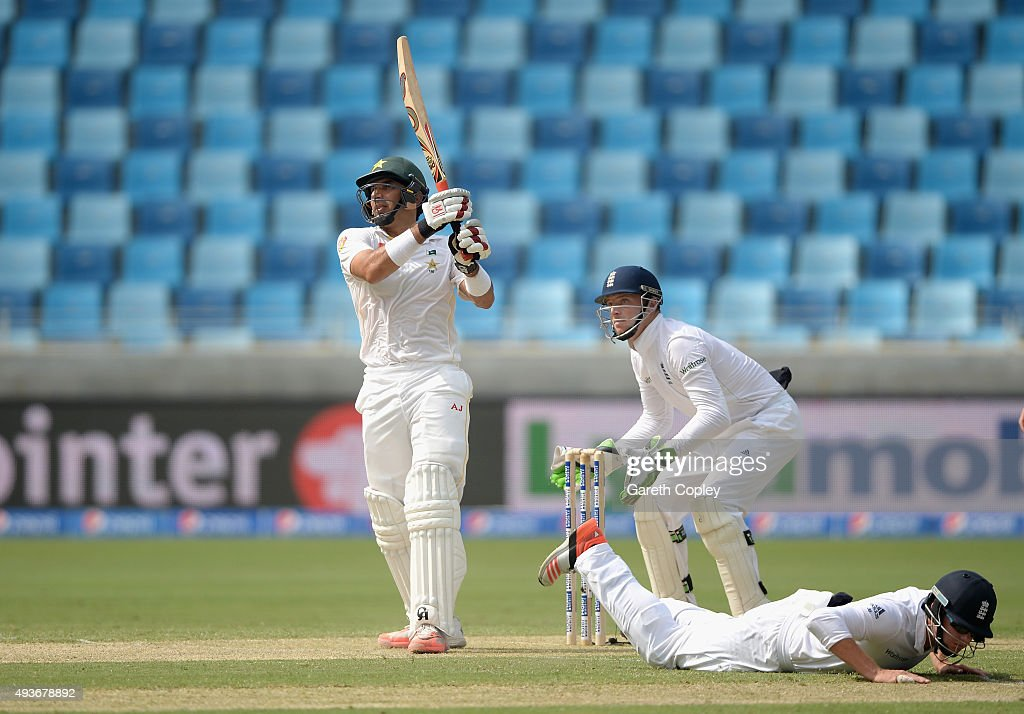 Pakistan captain Misbah-ul-Haq hits out as Jonathan Bairstow of England dives for cover during the 2nd test match between Pakistan and England at Dubai Cricket Stadium on October 22, 2015 in Dubai, United Arab Emirates.