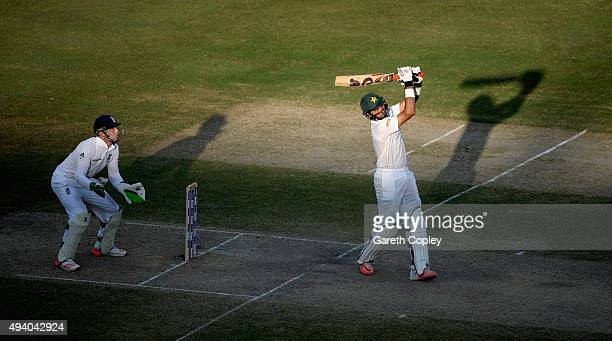 Pakistan captain MisbahulHaq hits out for six runs during day three of the 2nd test match between Pakistan and England at Dubai Cricket Stadium on...