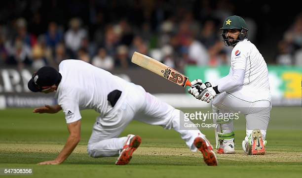 Pakistan captain MisbahulHaq hits past England captain Alastair Cook during the 1st Investec Test between England and Pakistan at Lord's Cricket...