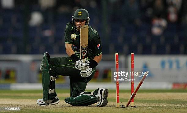 Pakistan captain MisbahulHaq is bowled by Jade Dernbach of England during the 3rd International Twenty20 Match between Pakistan and England at Sheikh...