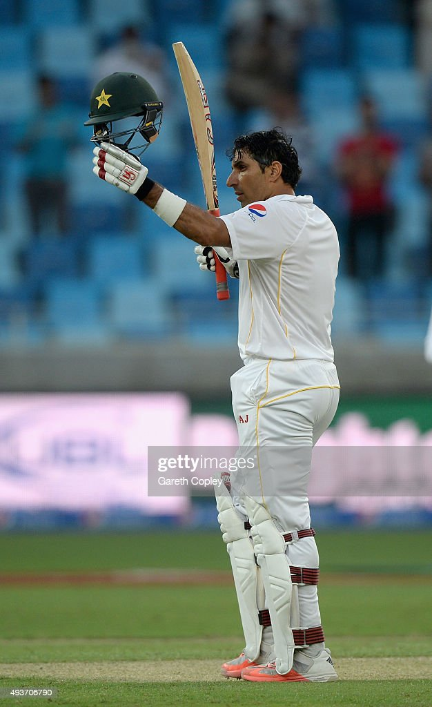 Pakistan captain Misbah-ul-Haq salutes the crowd after reaching his century during the 2nd test match between Pakistan and England at Dubai Cricket Stadium on October 22, 2015 in Dubai, United Arab Emirates.