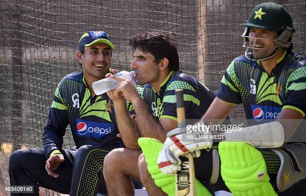 Pakistan captain MisbahulHaq shares a lighter moment with teammates Nasir Jamshed and Mohammad Irfan during their final training session for the 2015...