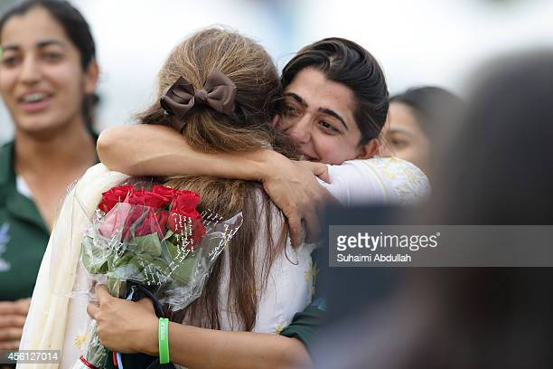 Pakistan captain Sana Mir gets a hug after helping Pakistan to beat Bangladesh to win the gold in the cricket women's final on day seven of the 2014...