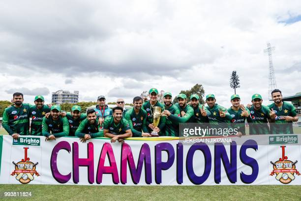 Pakistan captain Sarfraz Ahmed and his team hold the series trophy after victory during the final of the triseries played between Pakistan and...