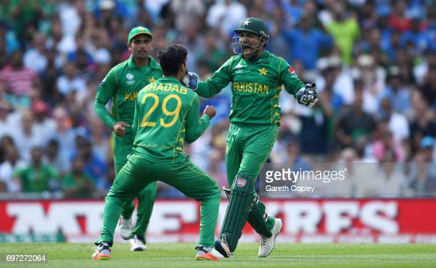 Pakistan captain Sarfraz Ahmed celebrates with Shadab Khan after catching out Kedar Jadhav of India during the ICC Champions Trophy Final between...