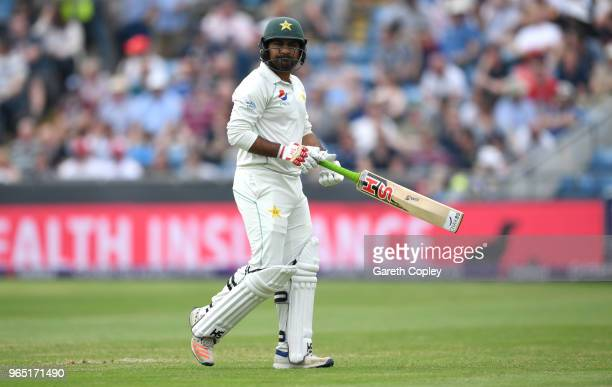 Pakistan captain Sarfraz Ahmed leaves the field after being dismissed by James Anderson of England during the 2nd NatWest Test match between England...