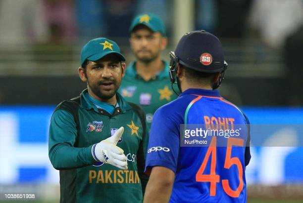 Pakistan captain Sarfraz Ahmed shakes hands with Indian captain Rohit Sharma during the Asia Cup 2018 cricket match between India and Pakistan at...