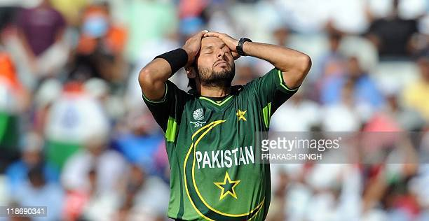 Pakistan captain Shahid Afridi reacts after dropping a catch off India batsman Sachin Tendulkar during the ICC Cricket World Cup 2011 semifinal match...
